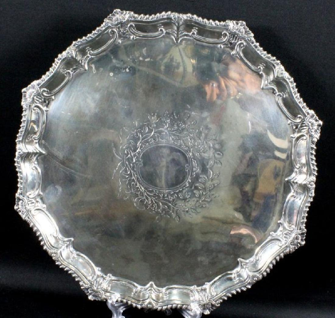 A GEORGE III SILVER FOOTED SALVER