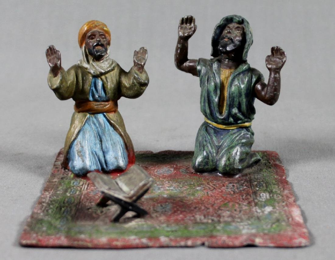 COLD PAINTED FIGURE OF 2 ARABS ON CARPET