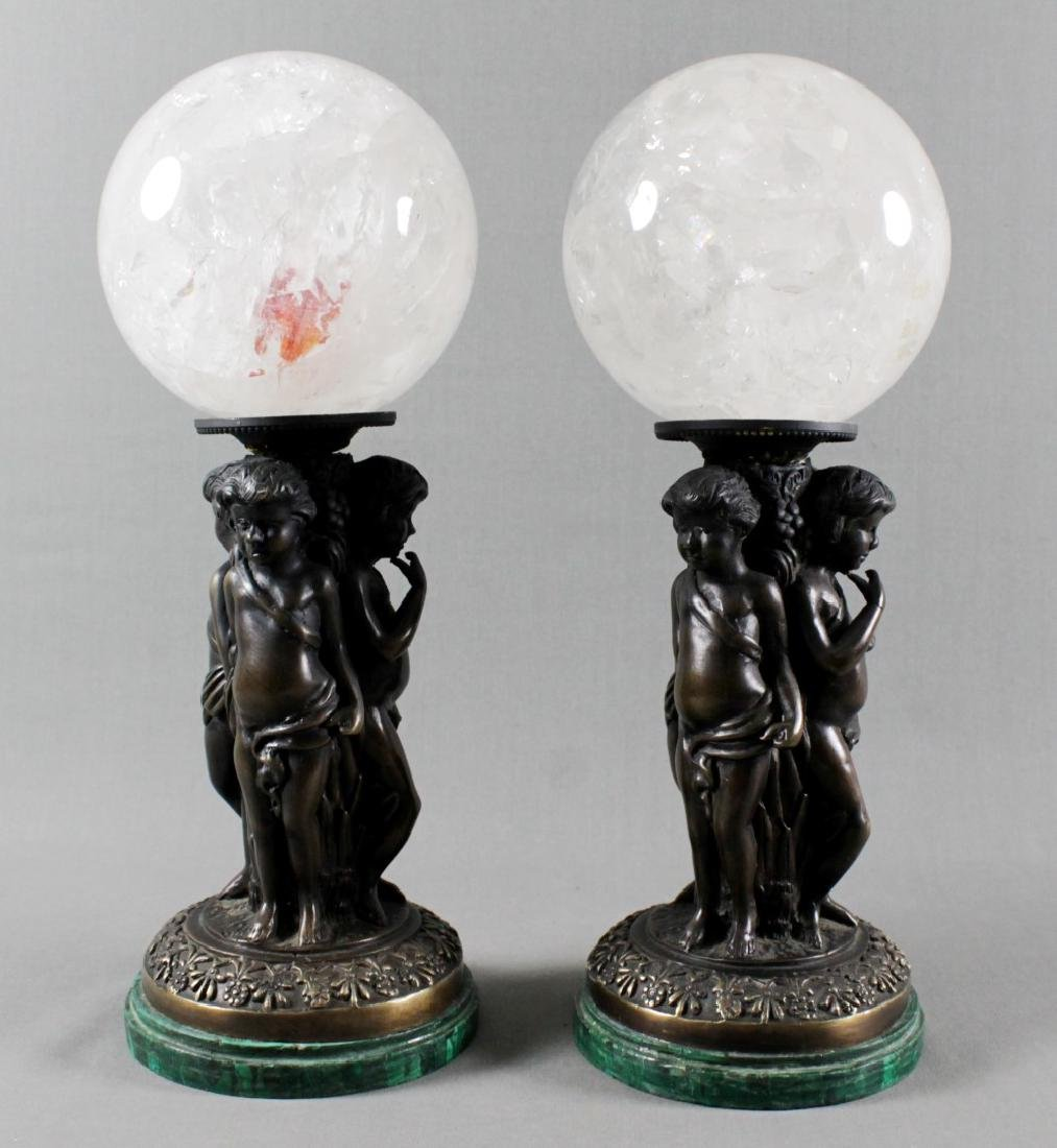 PAIR OF CRYSTAL SPHERES ON BRONZE BASES