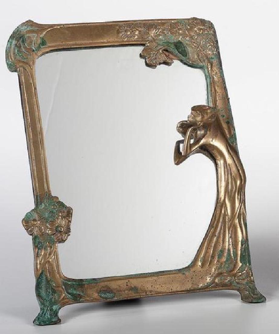 20th century. An Art Nouveau bronze mirror