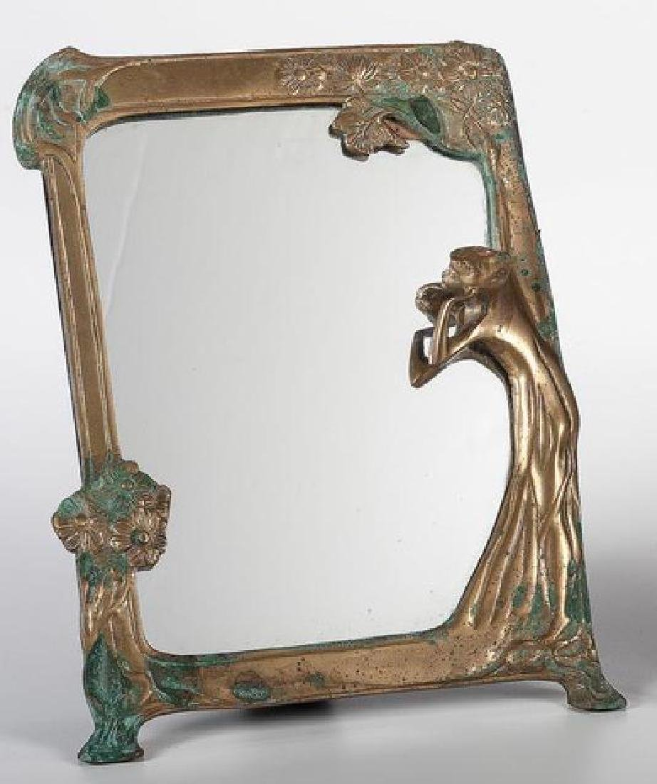 20th century. An Art Nouveau bronze mirror
