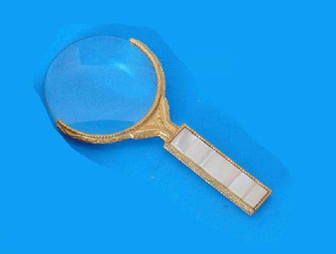 ANTIQUE BRASS AND MOTHER OF PEARL MAGNIFYING GLASS