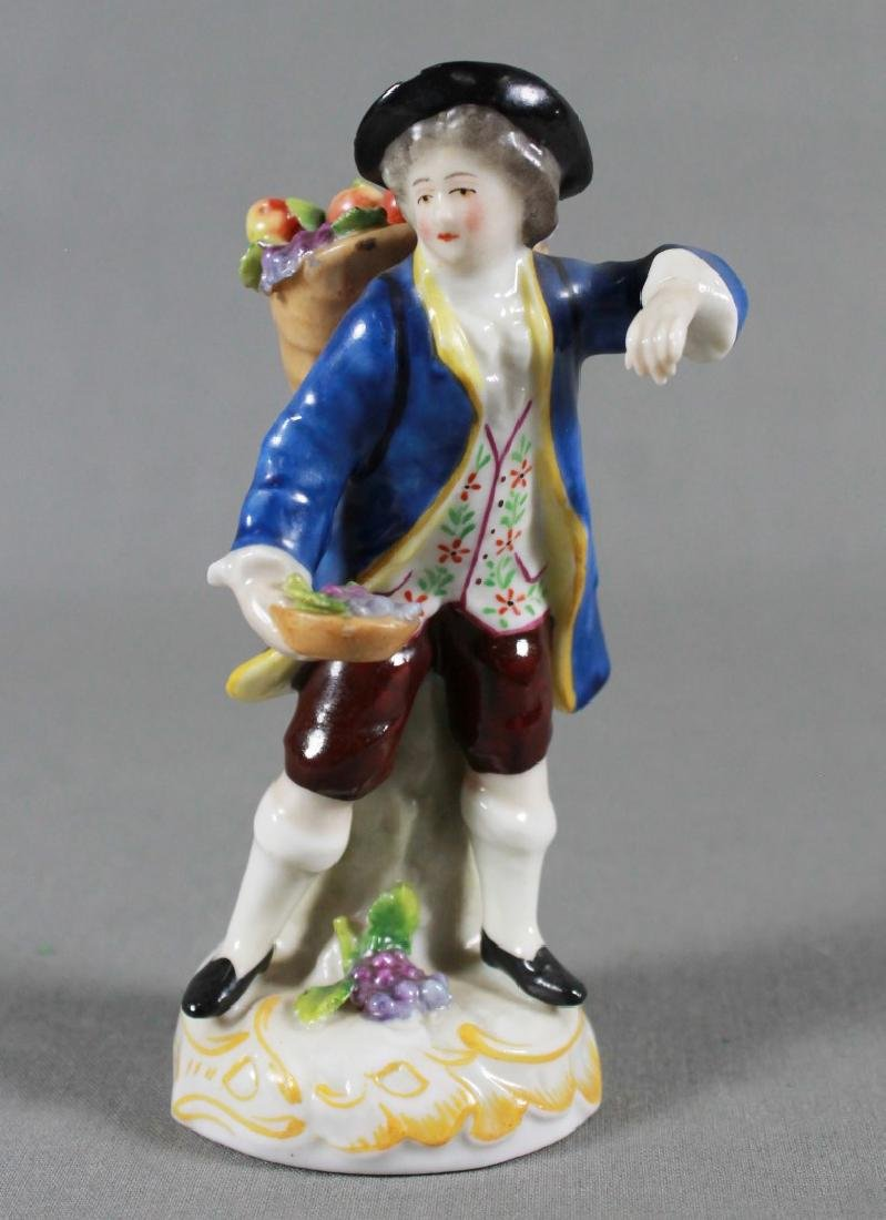 DRESDEN FIGURE OF BOY WITH FLOWERS