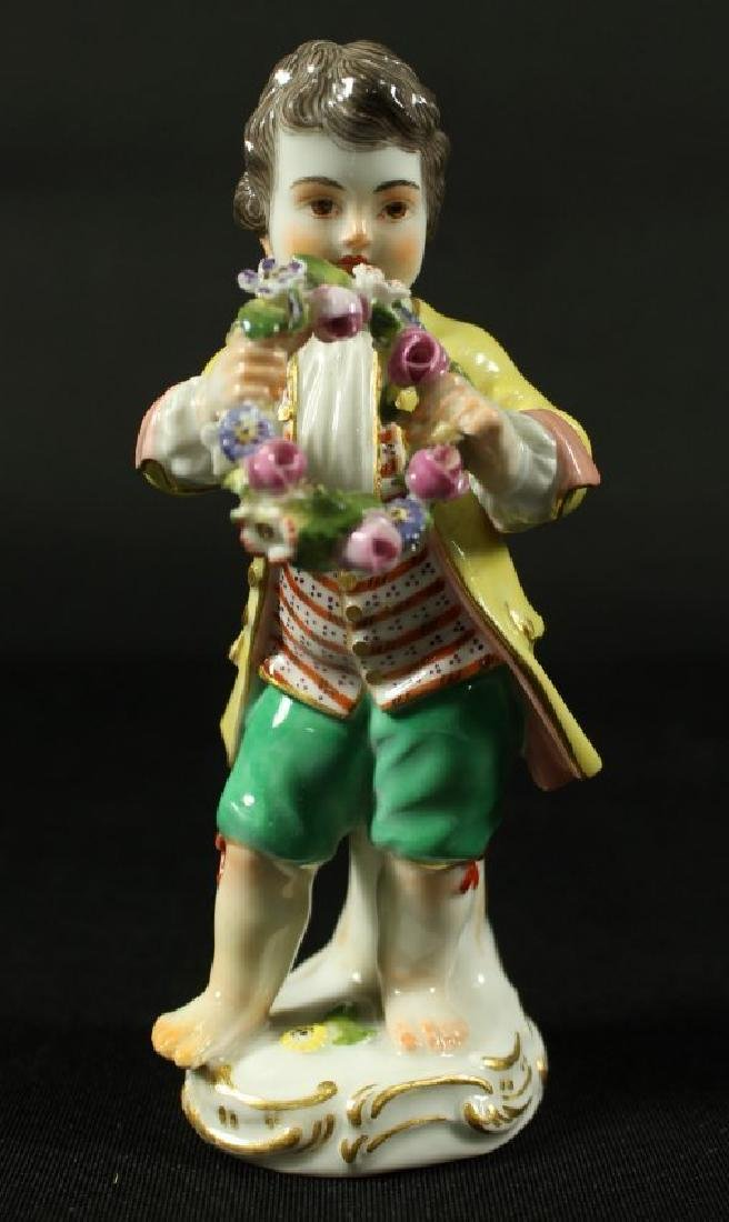 MEISSEN FIGURE OF CHERUB WITH REEF AND FLOWERS