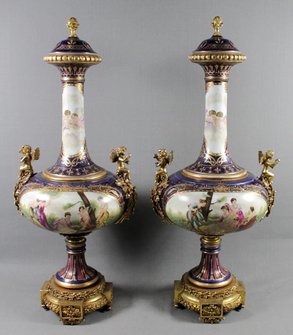 PAIR OF SEVRES STLYE VASES W/ BRONZE MOUNTS AND COVER