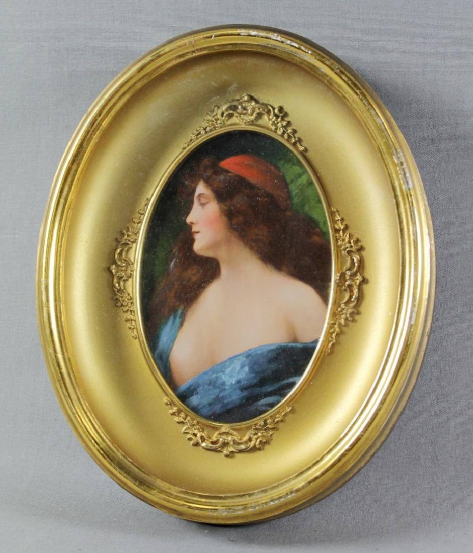 FRAMED OVAL PAINTING OF A WOMAN