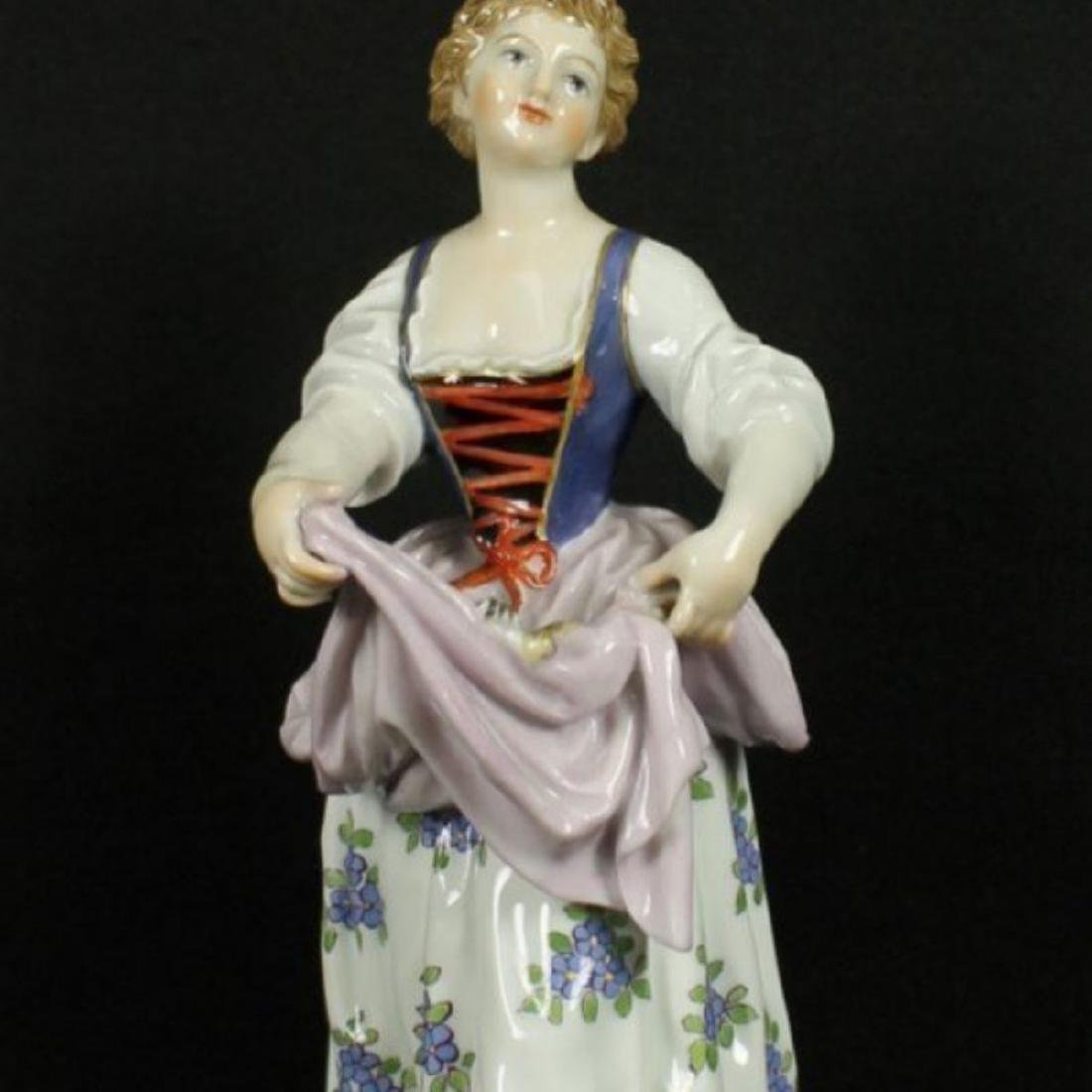 MEISSEN FIGURE OF WOMAN HOLDING DRESS