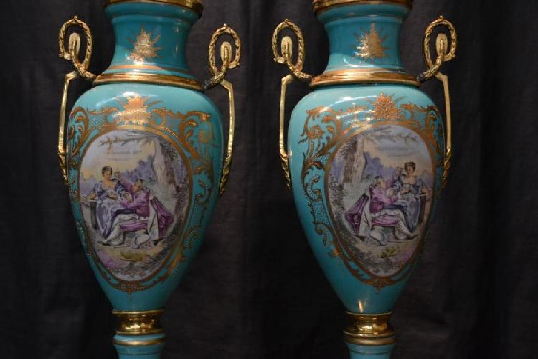 PAIR OF SEVRES STYLE COVERED URNS - 2