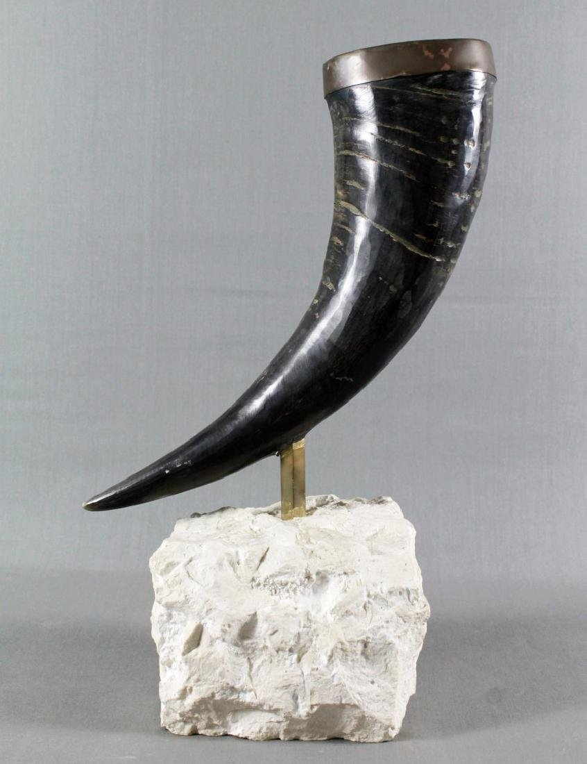 BRONZE HORN ON STONE BASE