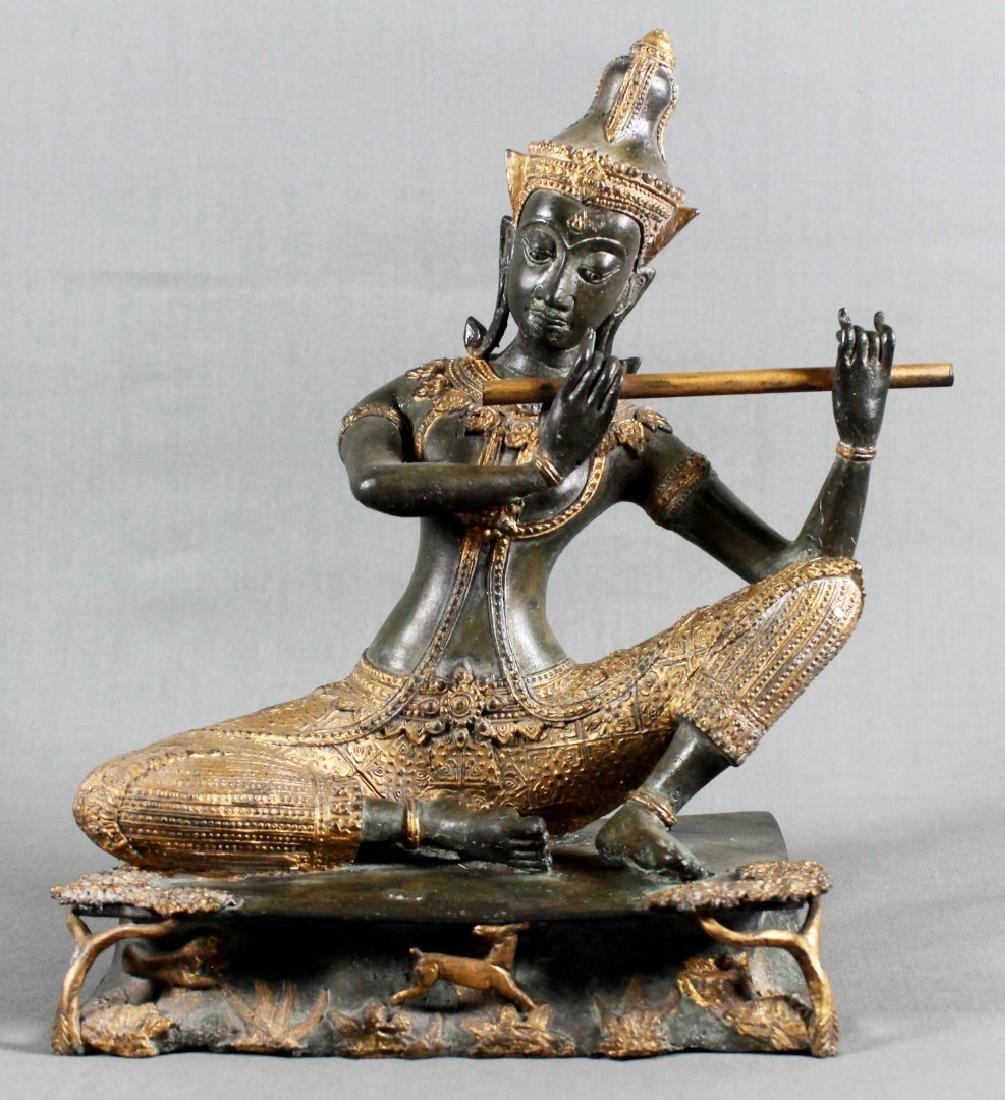 THAI GILT BRONZE OF A GODDESS PLAYING FLUTE
