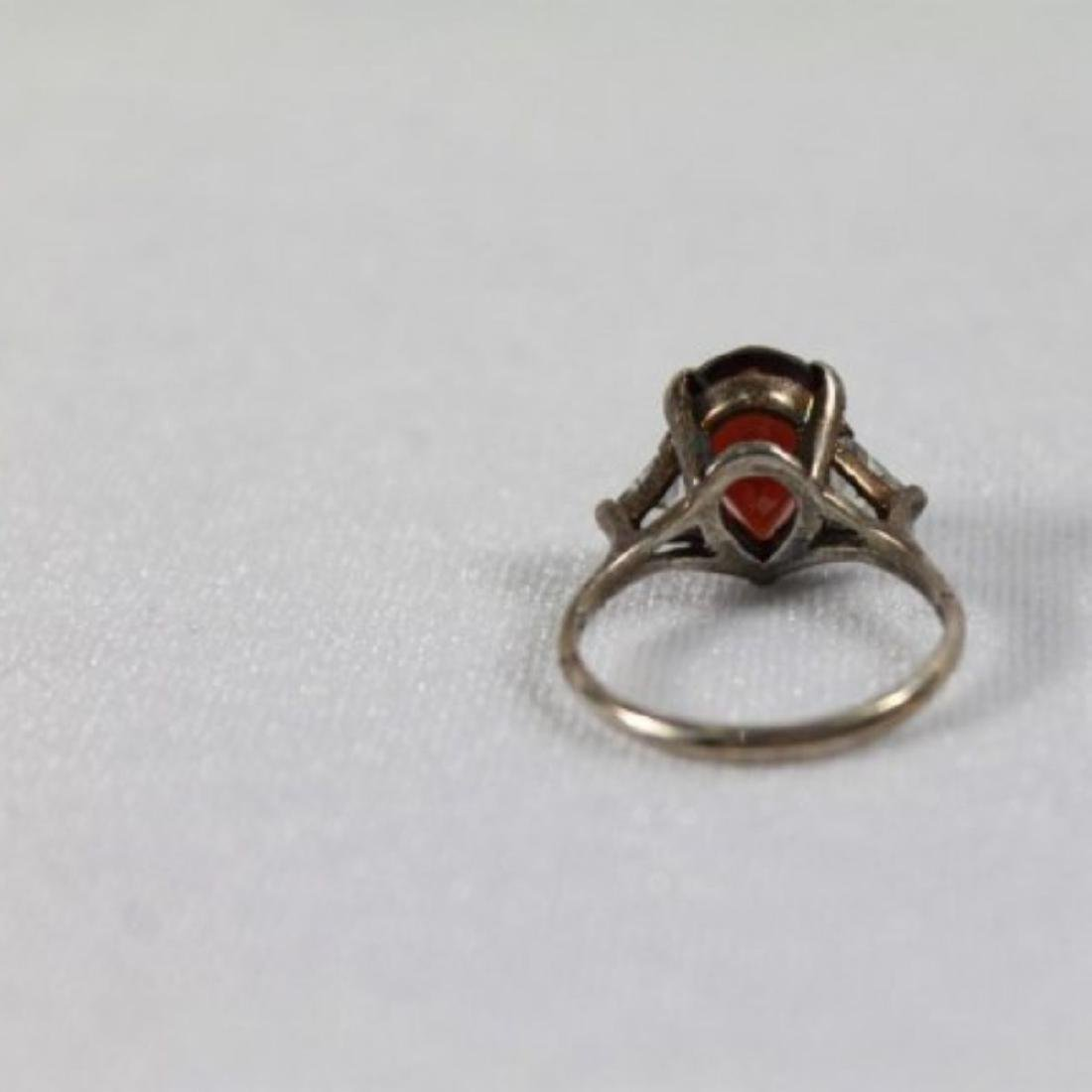 RED PEAR SHAPED RING WITH 2 WHITE TRILLIAN STONES ON - 7