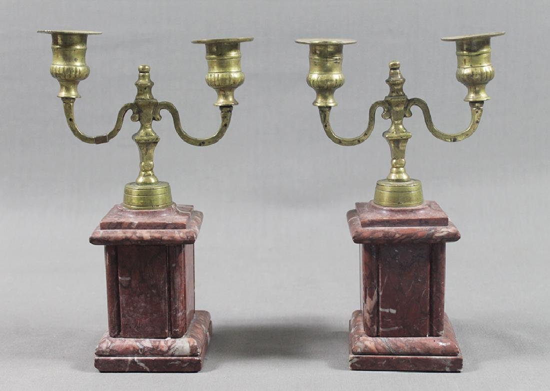 TWO BRASS AND MARBLE CANDLESTICKS