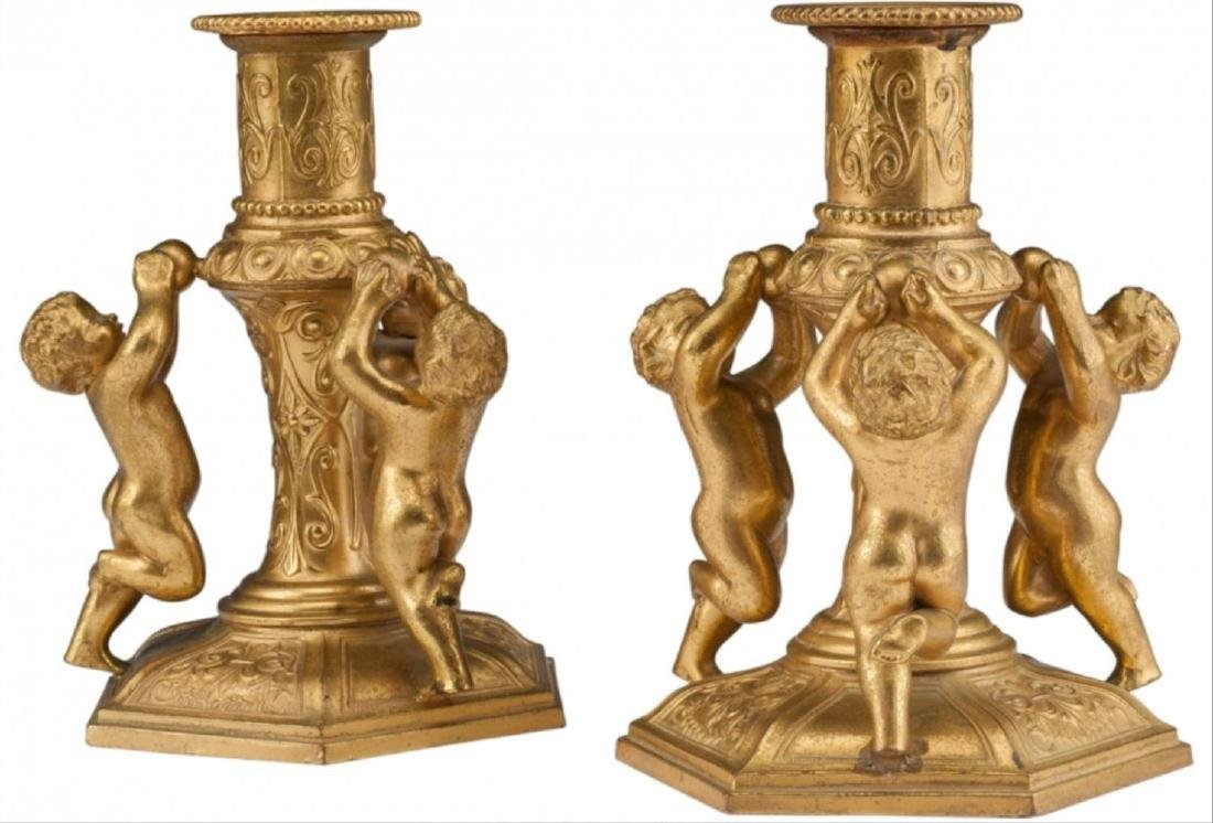 A Pair Of Continental Gilt Bronze Figural Candles