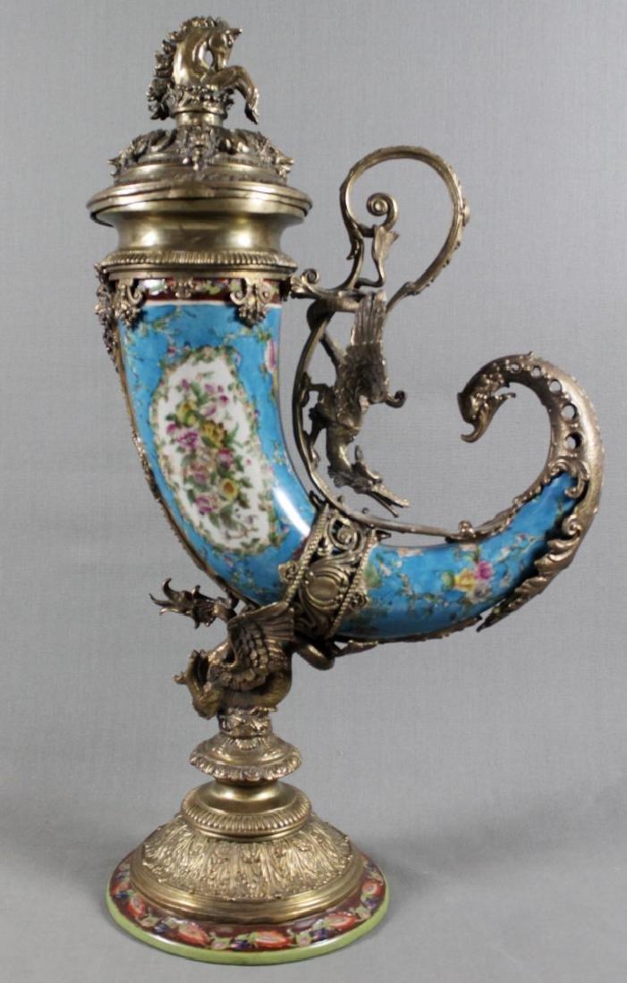 A Continental Porcelain Cornucopia Urn Bronze Mounted