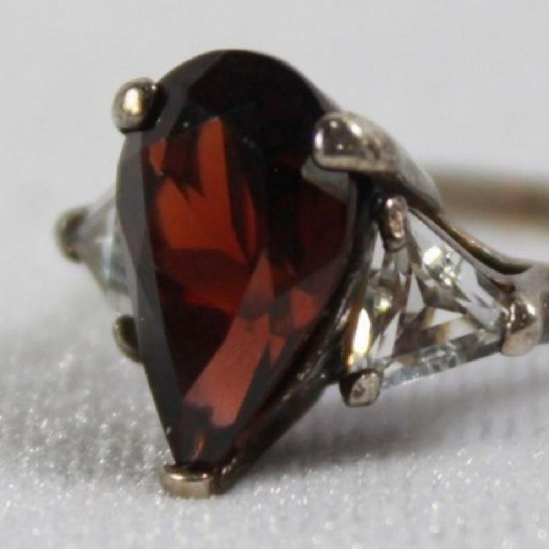 Red Pear Shaped Ring With 2 White Trillian Stones On