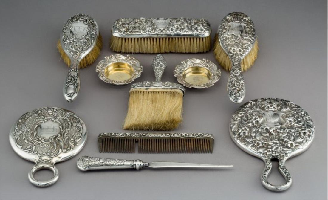 Nine Gorham Repouss Silver Vanity Items With A