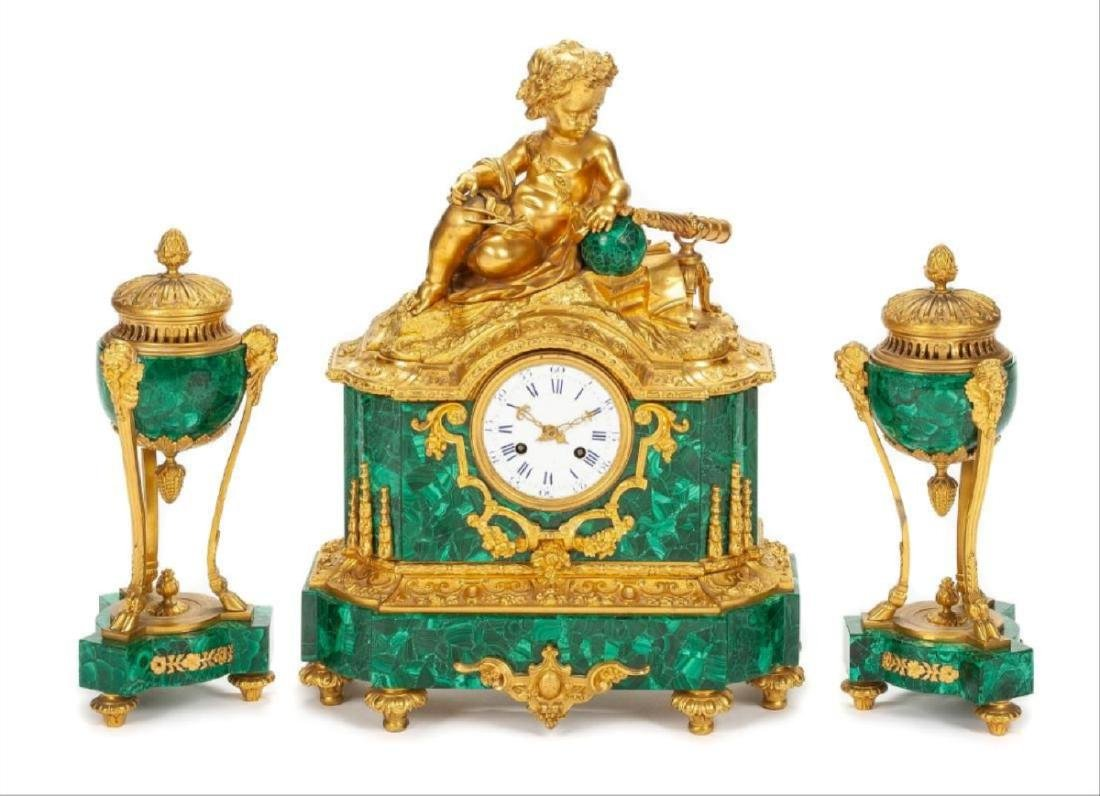 A French Gilt Bronze And Malachite Clock Garniture