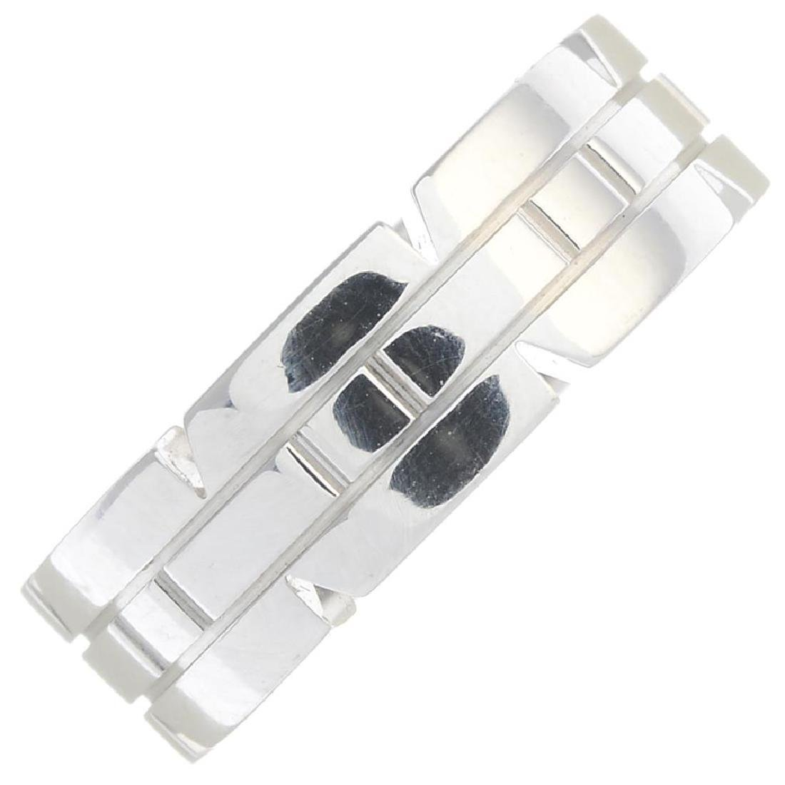 Cartier - A 'Tank Francaise' Band Ring. Designed With A