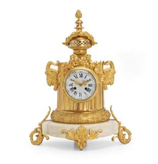 A French White Marble And Gilt Bronze Clock
