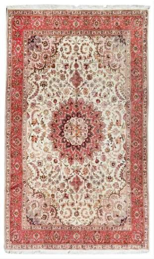 A Tabriz Wool And Silk Rug