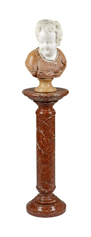 A Marble Bust And Pedestal