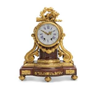 A French Red Rouge Marble And Gilt-Bronze Clock