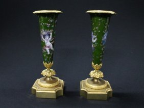 7: Pair of painted Limoges vases featuring putti with f