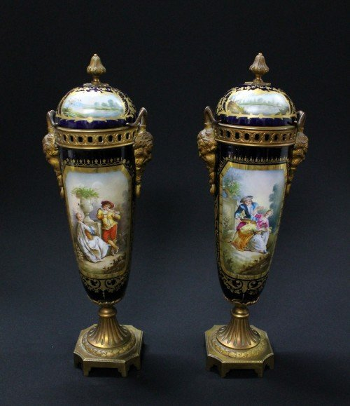 13: A PAIR OF SERVE STYLE BRONZE MOUNTED PAINTED AND GI