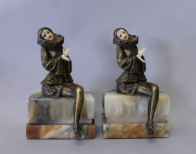PAIR OF ART DECO BRONZE AND IVORINE BOOKENDS