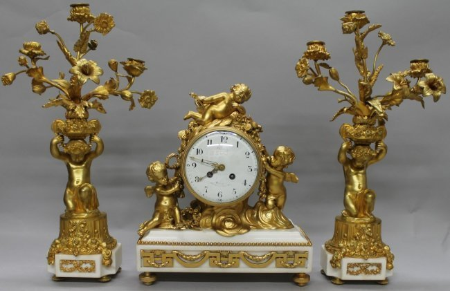 19th century gilt bronze and marble clock set