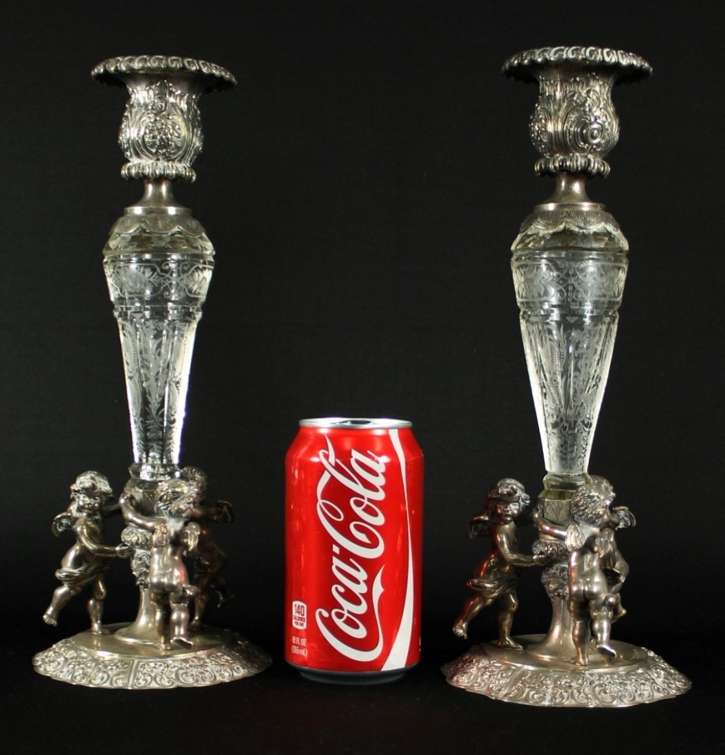 PAIR OF CONTINENTAL SILVER AND ROCK CRYSTAL CANDLESTICK