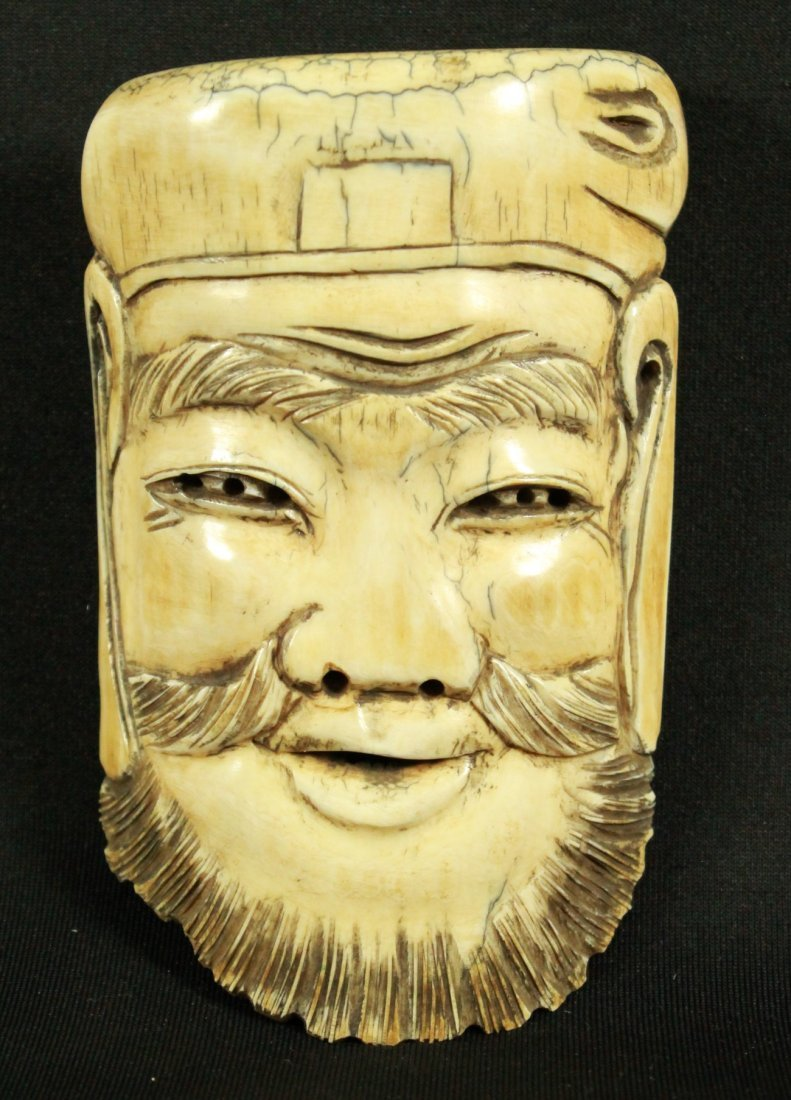 CHINESE IVORY CARVING OF MANS FACE