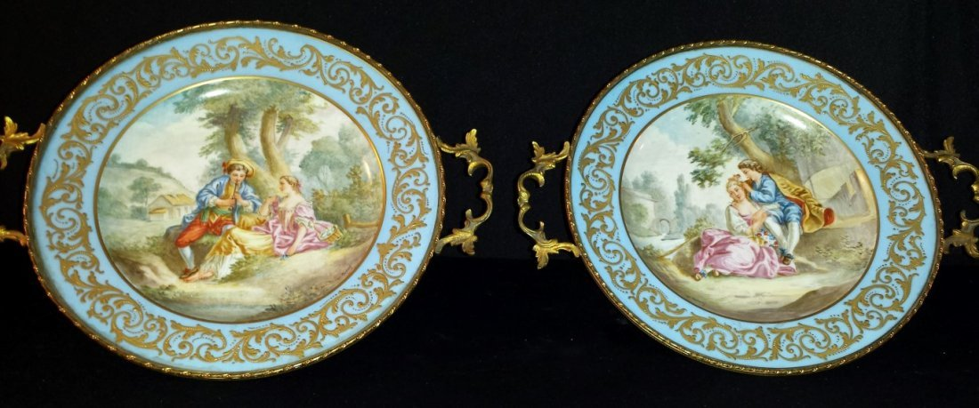 PAIR OF ANTIQUE BRONZE AND SEVRES CENTERPIECES
