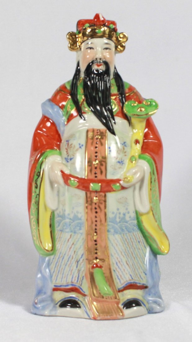 CHINESE PORCELAIN FIGURE OF A MAN