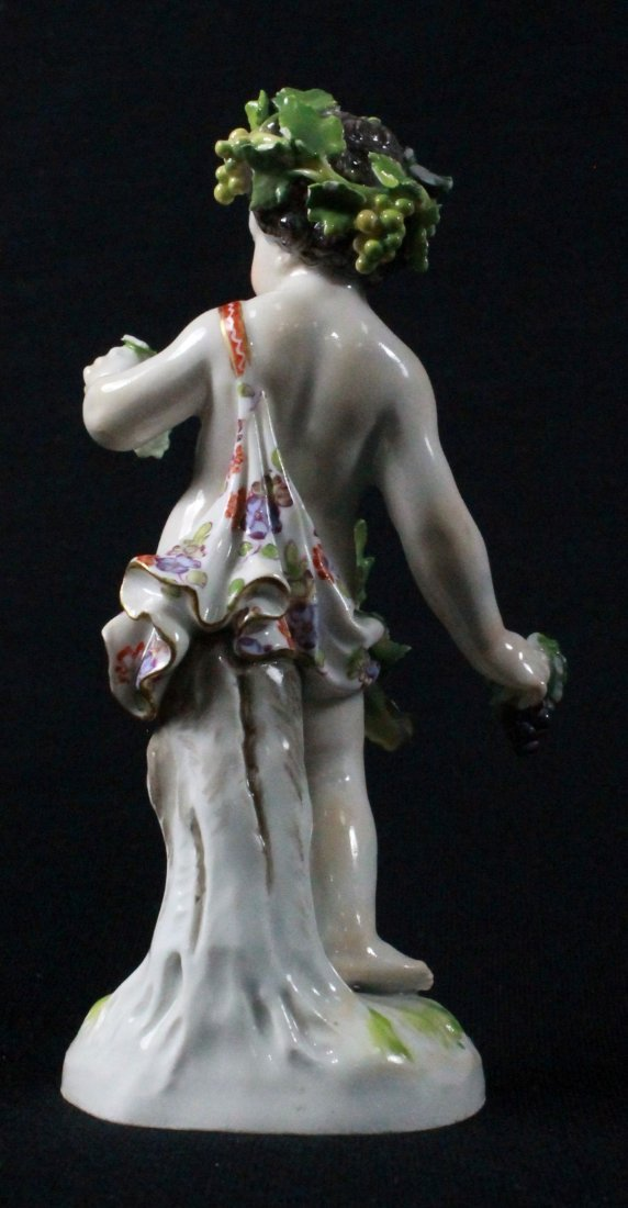 MEISSEN FIGURE OF A BOY HOLDING GRAPES