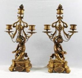 Pair Of Bronze Figural Cherub Candelabra