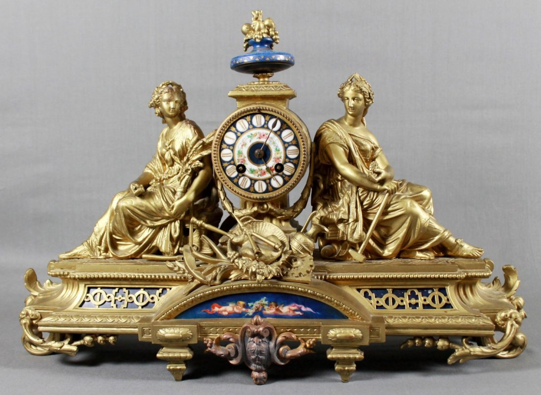 FRENCH BRASS FIGURAL MANTLE CLOCK