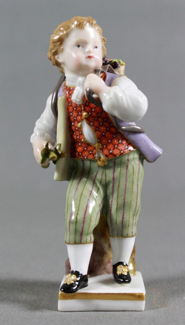 ANTIQUE MEISSEN FIGURE OF A BOY CARRYING BASKET OF