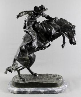 BRONZE GROUP OF MAN ON HORSE SIGNED FREDERICK ROMINGTON
