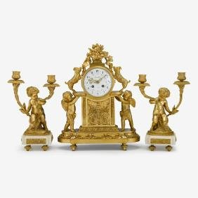 19th Century French Louis XV style gilt bronze clock