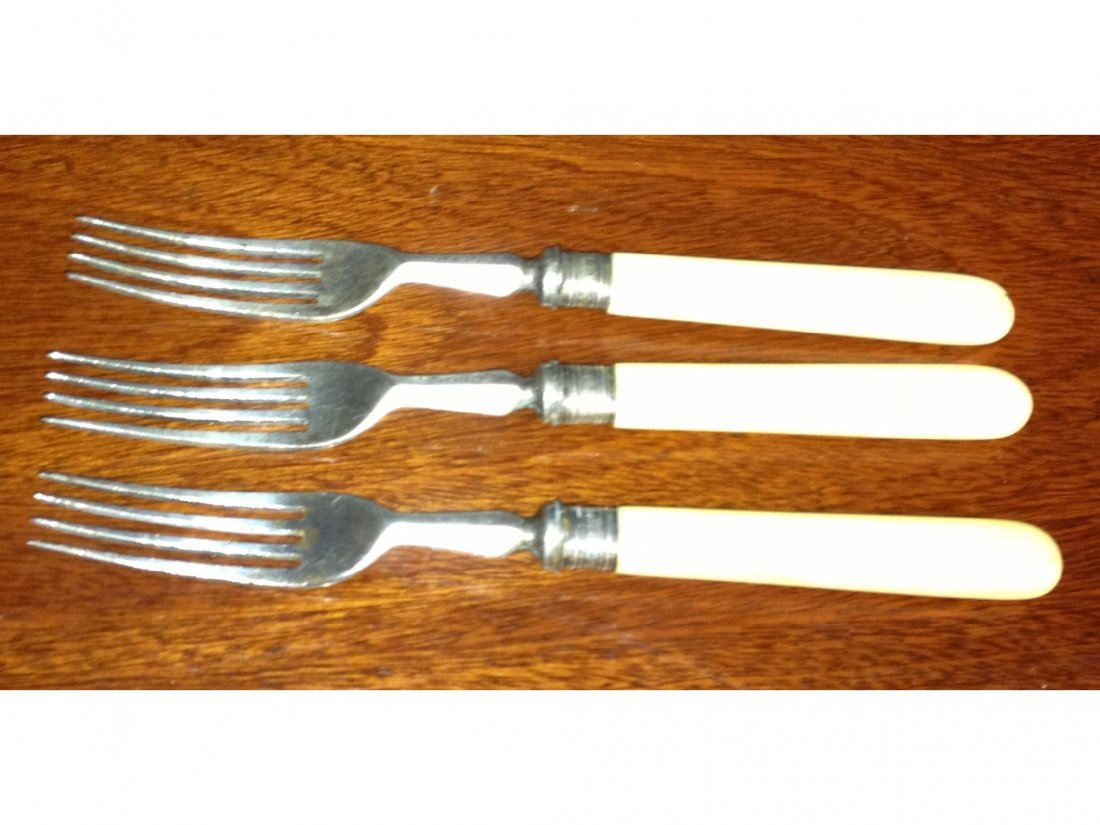 11: Three silver plate bone handled forks with silver b