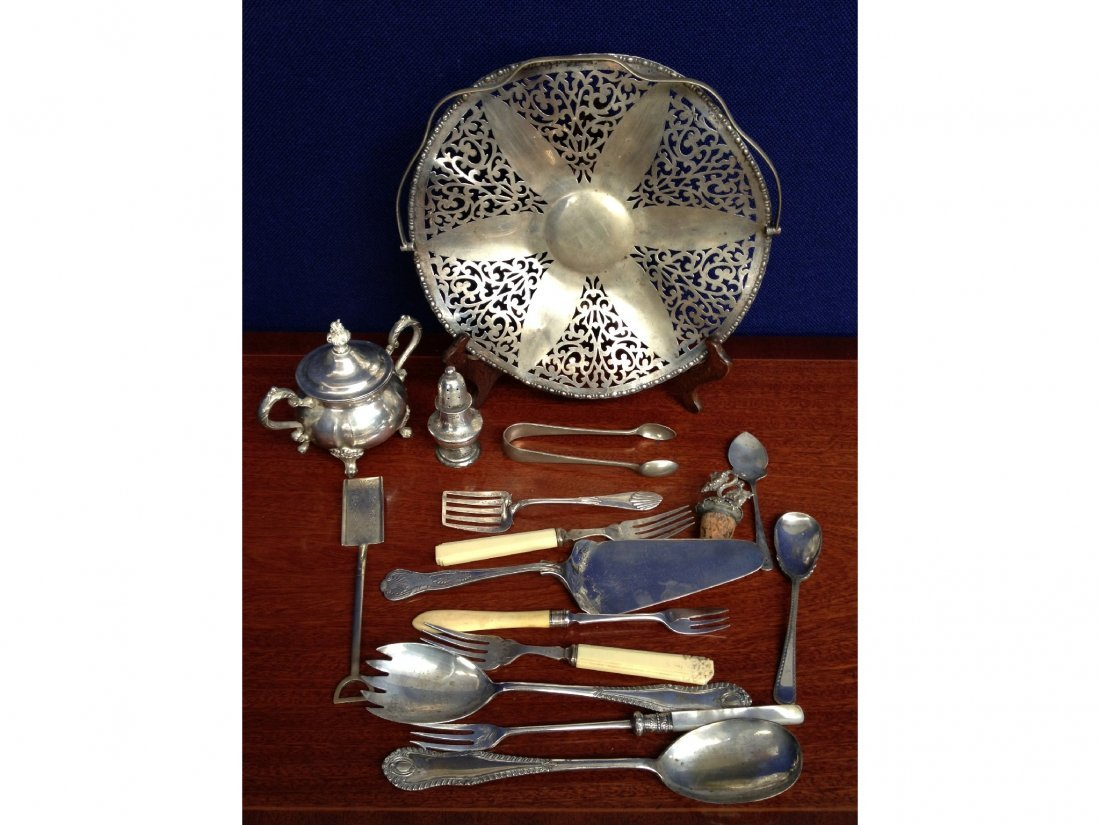 12: A silver pepper pot (London,1905) together with a s