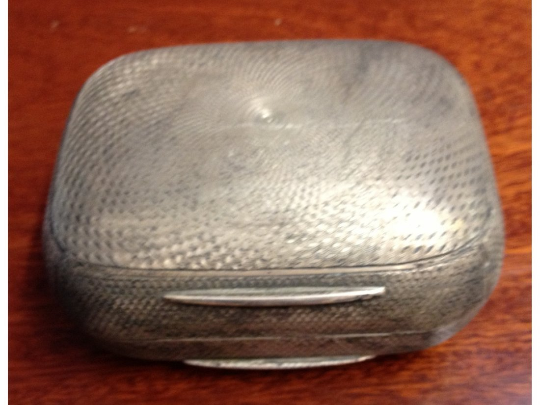 16: A silver engine turned soap dish (London, 1919).