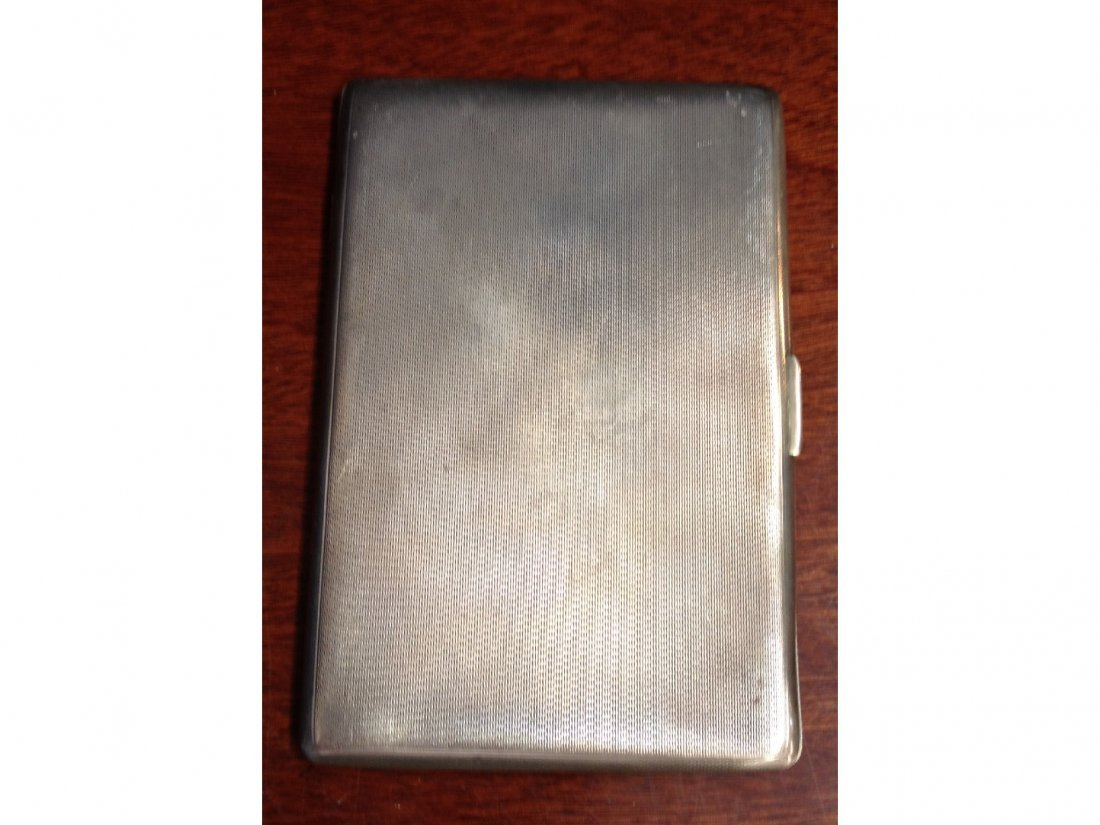 17: A silver engine turned cigarette case, engraved mes