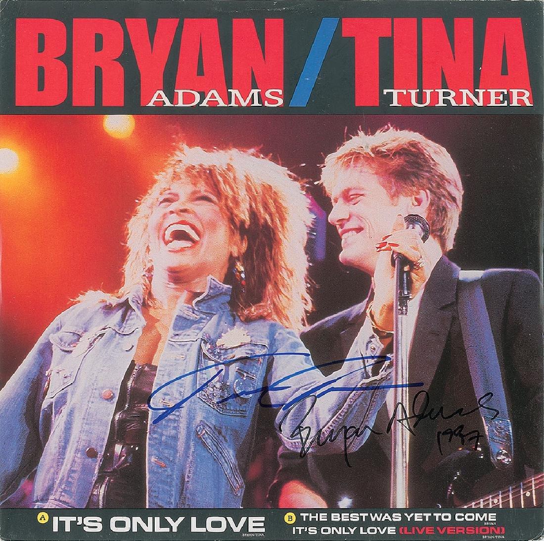 Bryan Adams and Tina Turner Signed Album