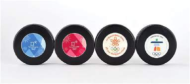 Winter Olympics Group of 4 Hockey Pucks