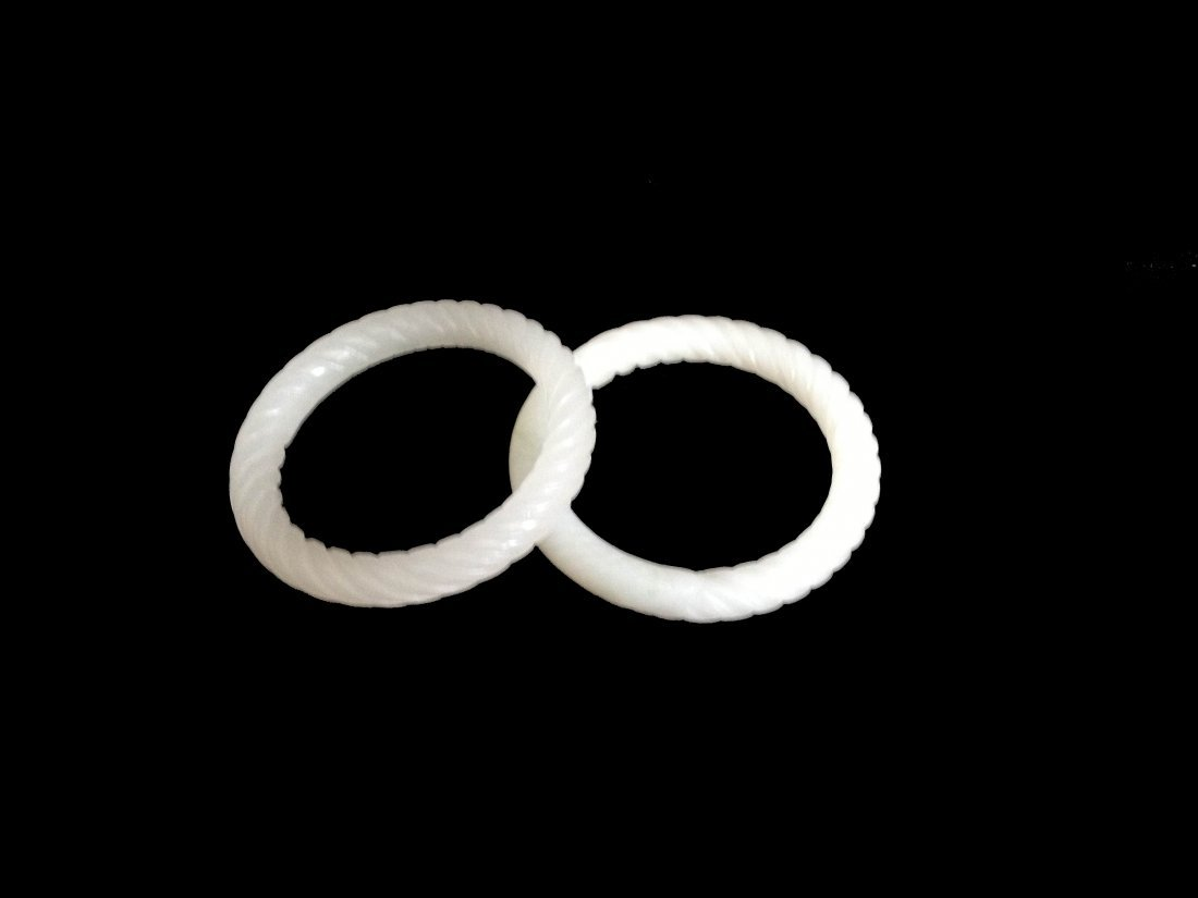 Two White Jade Twisted Bangles.