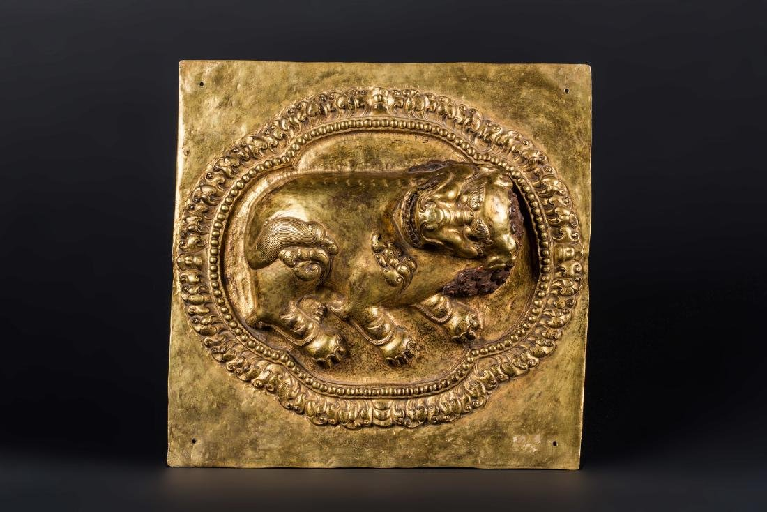 Arte Himalayana  An embossed gilt copper plaque with