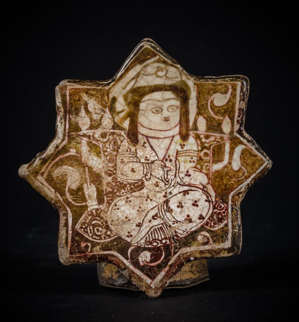 ARTE ISLAMICA  A Kashan lustreware star shaped