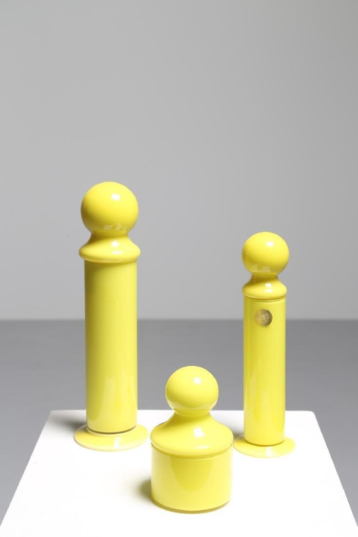 CARLO MORETTI Tre contenitori in vetro giallo, Murano
